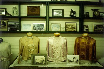 Antique clothing and photographs.